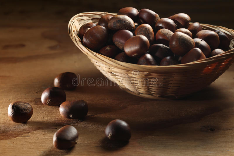 Download Whole chestnuts in basket stock photo. Image of brown - 14376022