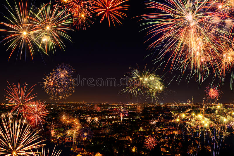 Whole city celebrating with fireworks. Whole city celebrating the New Year or any national event with fantastic multi-colored fireworks, copyspace on the night royalty free stock image