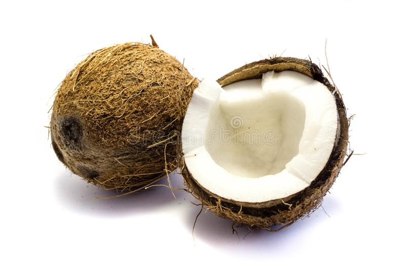 A whole coconut and a broken coconut isolated on white background stock photography