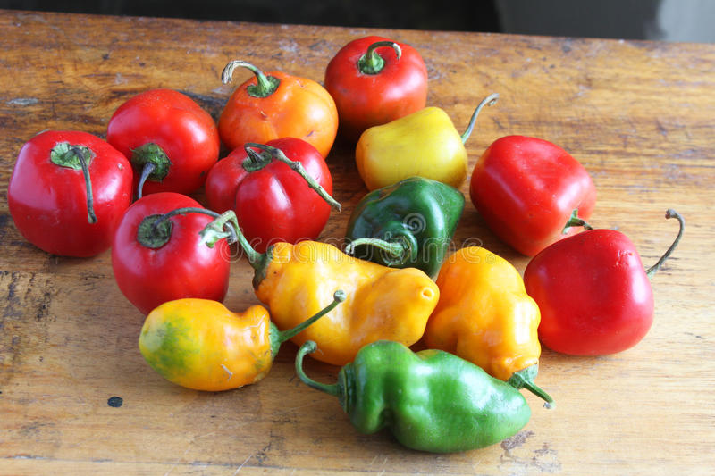 Whole, Colorful Hot Peppers on a Table royalty free stock photos
