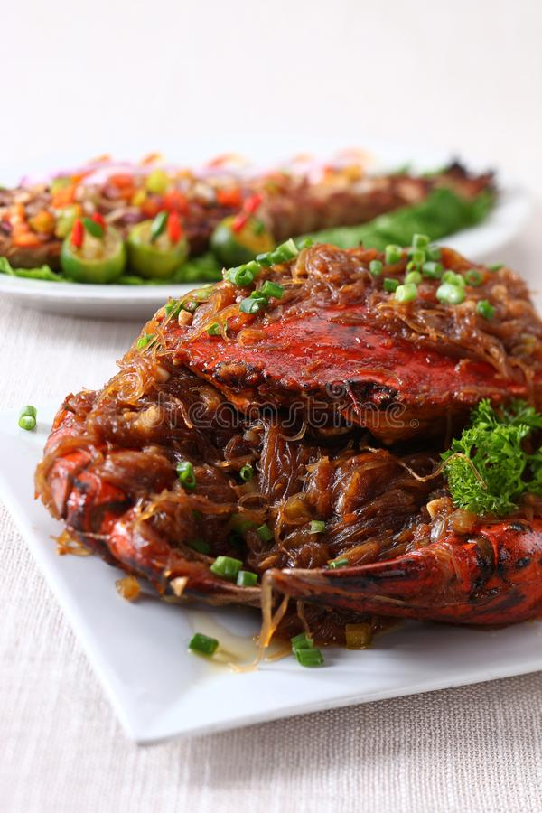 Whole crab on plate. On linen stock photos