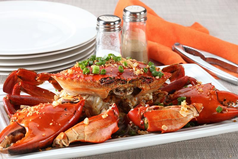 Whole crab on plate. With fried garlic stock photography