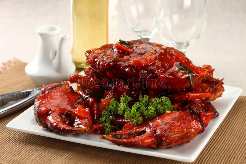 Whole crab in red sauce. On linen royalty free stock image