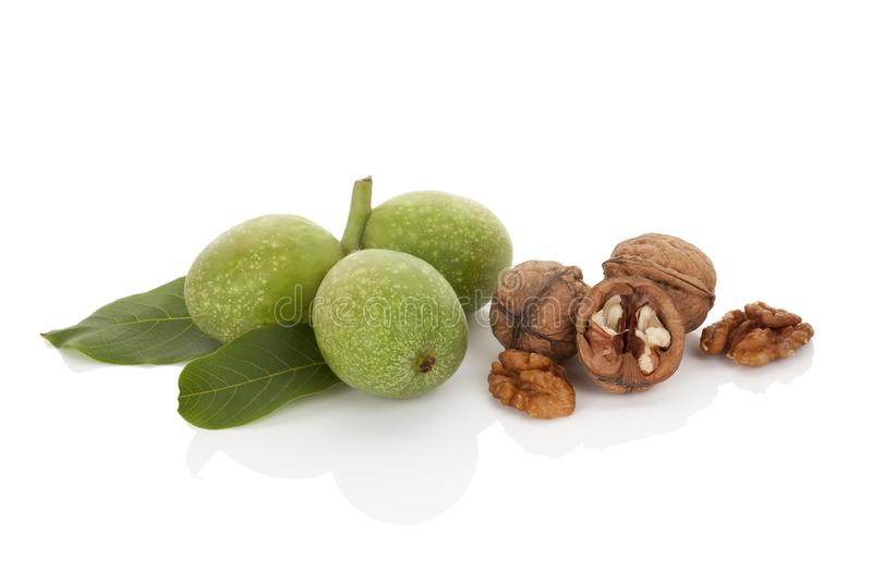 Whole and cracked walnuts stock images
