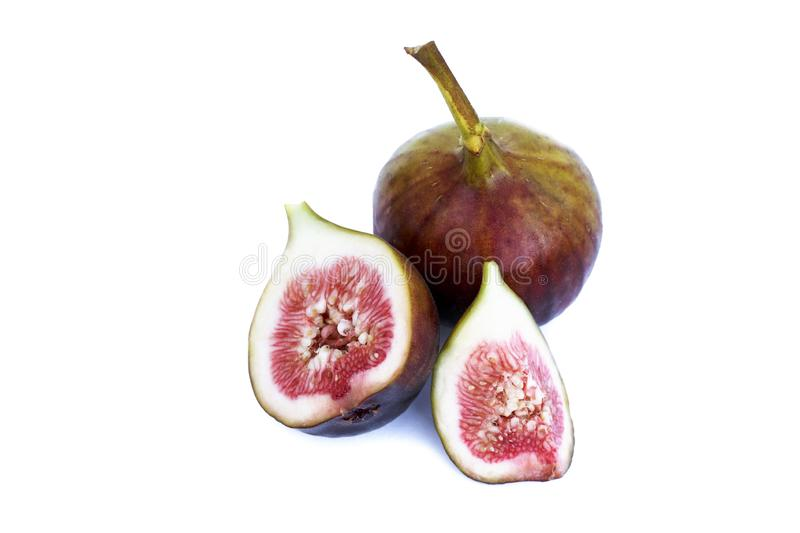 Whole and cut figs close-up isolated on white background. Whole and cut figs close up isolated on white background royalty free stock photography