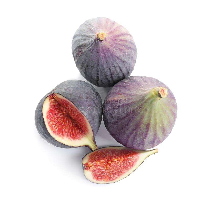 Whole and cut purple figs on white, top view royalty free stock image