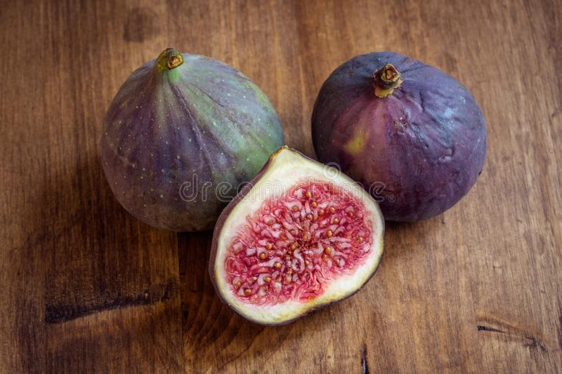 Whole and cut ripe figs shot from high angle royalty free stock photo