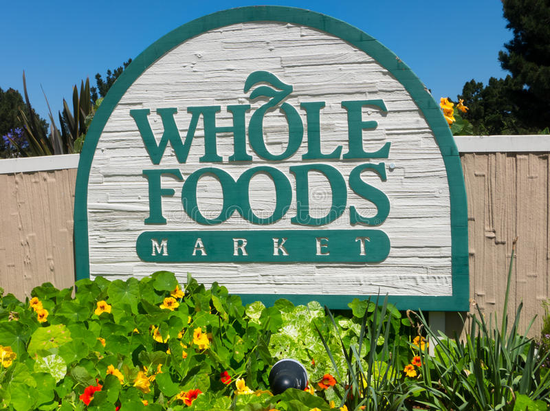 Whole Food Market exterior sign. MONTEREY, CA/USA - APRIL 10, 2014: Whole Food Market exterior sign. Whole Foods is an American foods supermarket chain stock photo