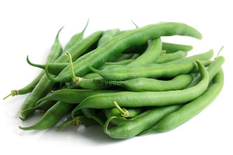 Whole French green string beans isolated on white. Whole French green string beans isolated on white royalty free stock photo