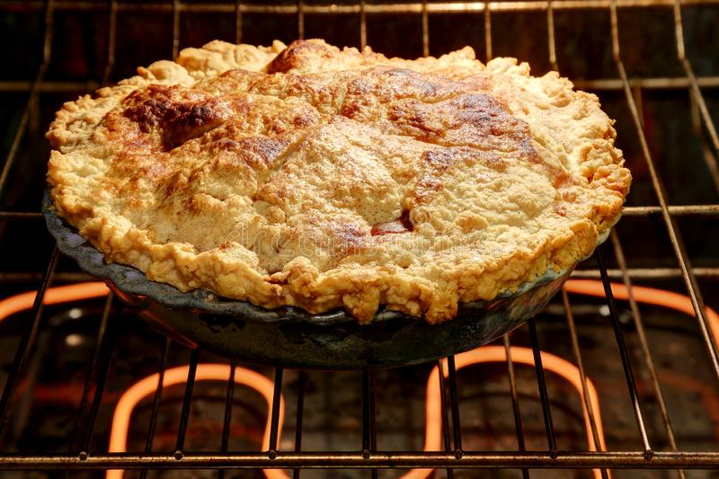 Whole fresh baked apple pie. Delicious whole fresh baked rustic Apple Pie straight from the oven royalty free stock image