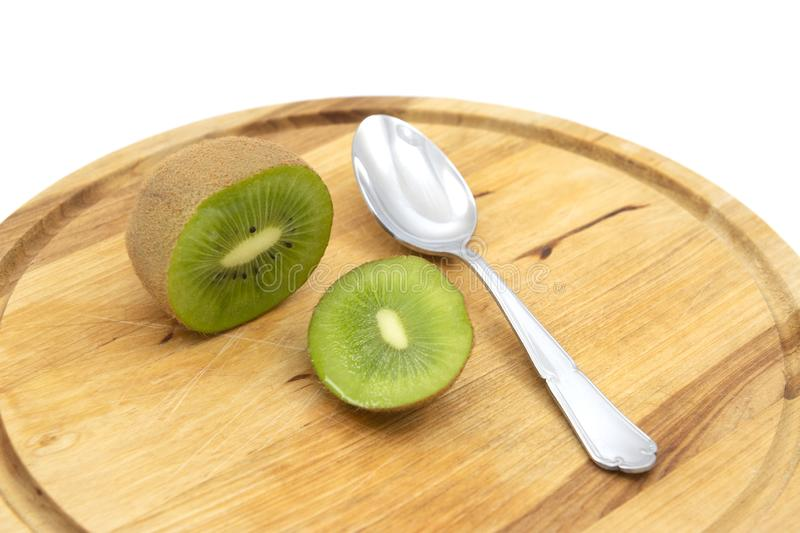 Whole fresh kiwifruit cut open, to be eaten with a spoon royalty free stock images