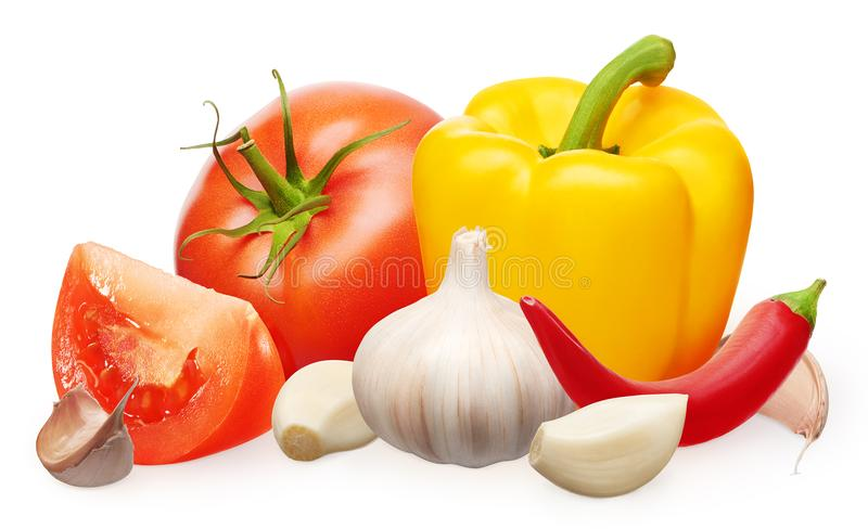 Red tomato, yellow bell and chili peppers, garlic with cloves stock photos