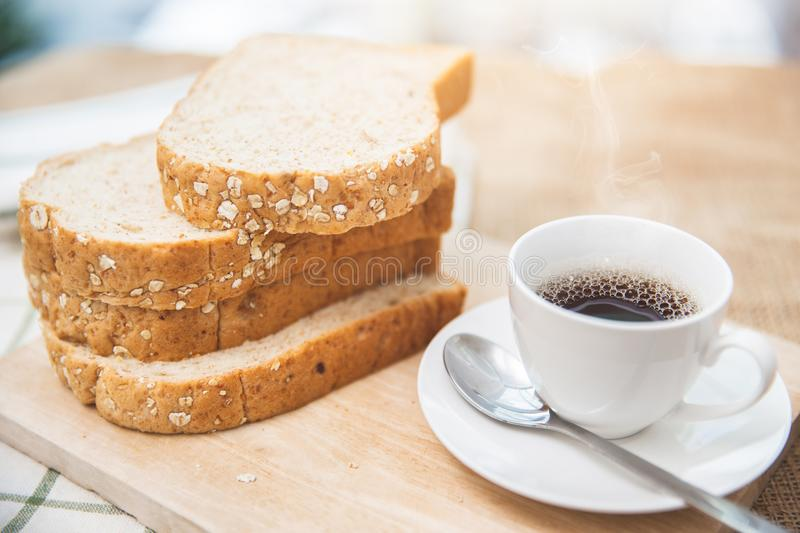 Whole grain bread with black coffee good healthy morning. Meal low fat food royalty free stock photos