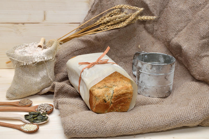 Whole Grain Bread, Seeds, Flour and Sifter royalty free stock images