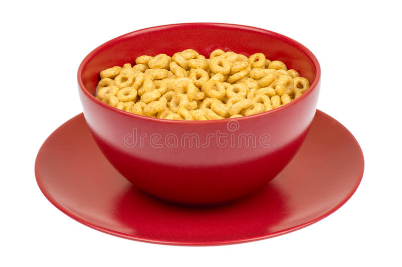 Whole grain cheerios cereal in the red bowl. royalty free stock photography