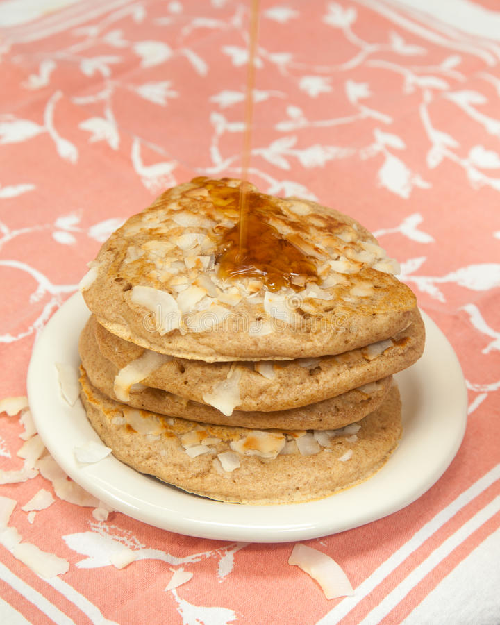 Whole Grain Coconut Pancakes with Maple Syrup royalty free stock images