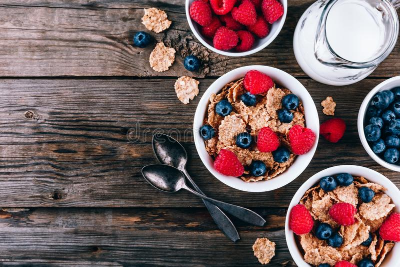 Whole Grain healthy cereals with fresh blueberries and raspberries for breakfast royalty free stock photos