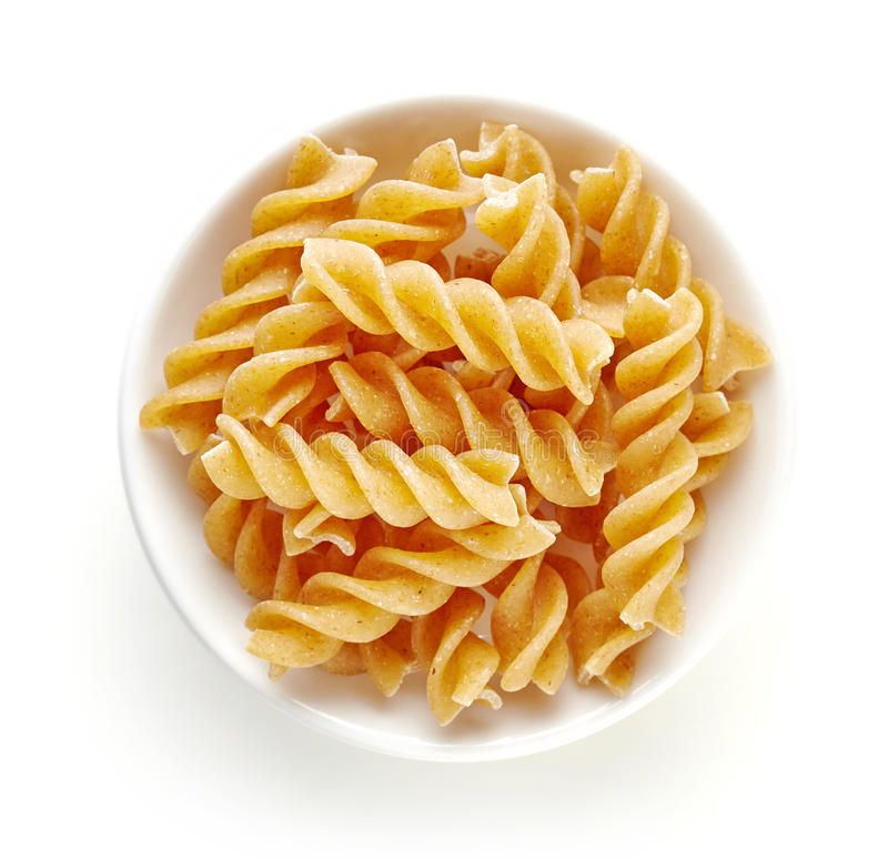 Free Whole Grain Pasta In Bowl Isolated On White, From Above Royalty Free Stock Photo - 90343695