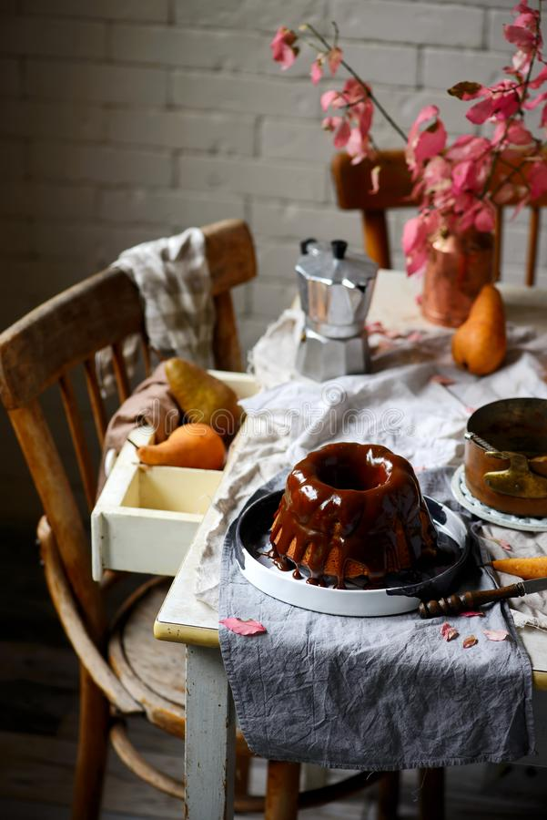 Whole Grain Pear cake with Caramel Glaze .selective focus royalty free stock image