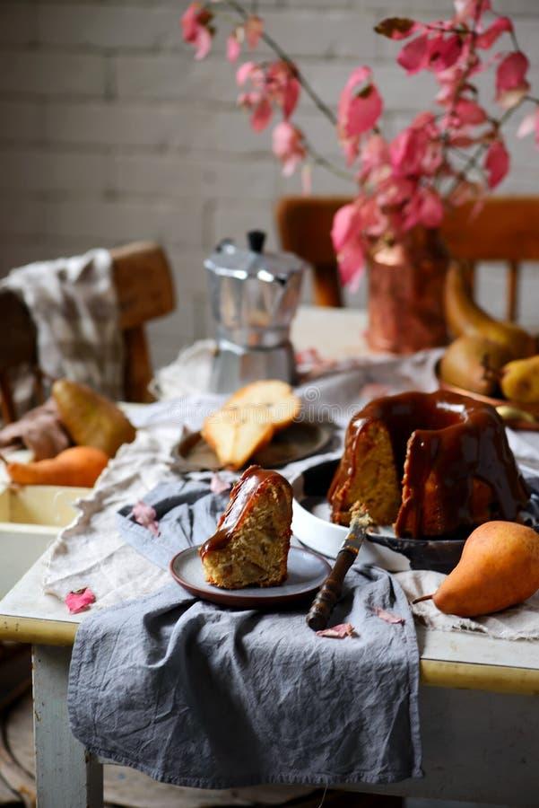 Whole Grain Pear cake with Caramel Glaze .selective focus stock photography