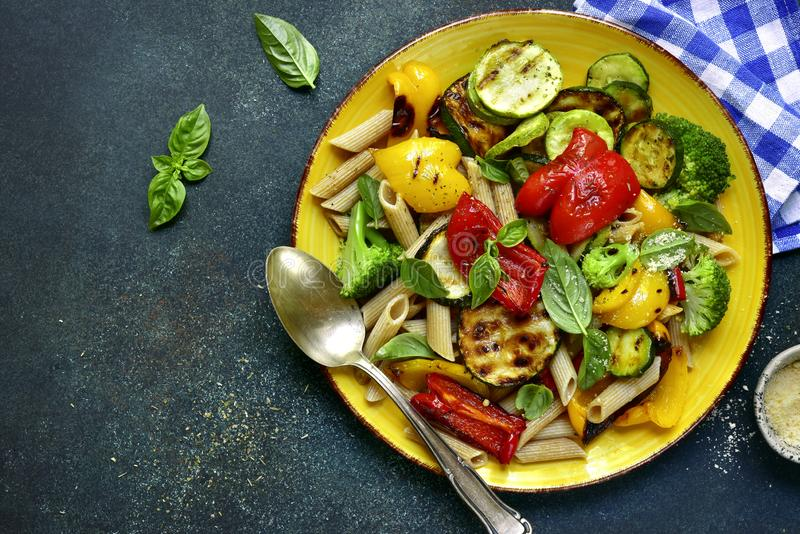 Whole grain penne pasta with grilled vegetables.Top view with co royalty free stock photos