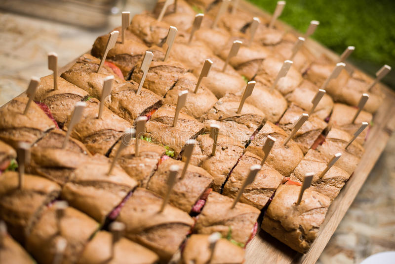 Whole grain sandwichs ( canape ) with Italian salami, goat cheese and salat. Grain sandwichs ( canape ) with Italian salami stock photography