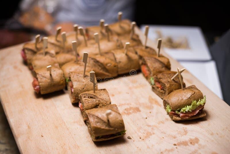 Whole grain sandwichs ( canape ) with Italian salami, goat cheese and salat. Whole grain sandwichs ( canape ) with Italian salami stock image