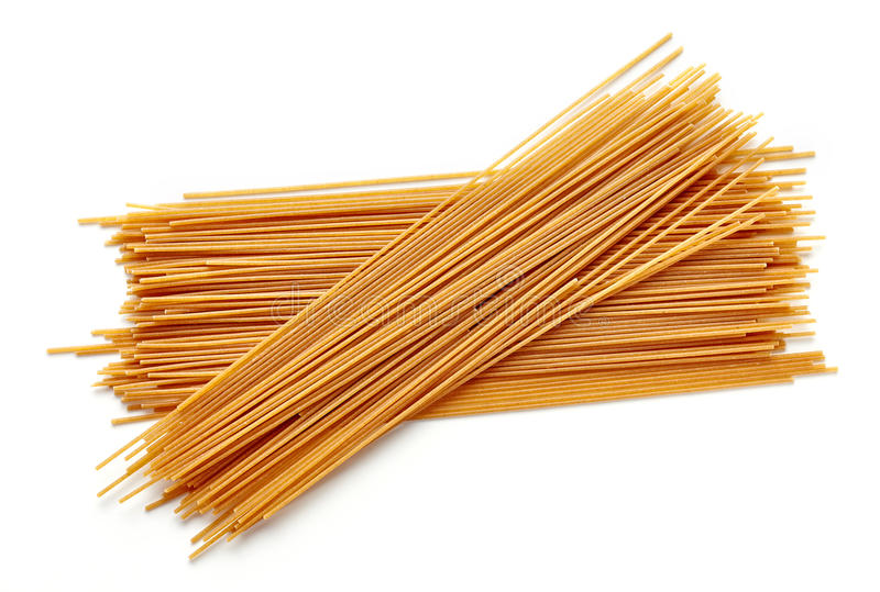 Whole grain spaghetti pasta isolated on white, from above. Spaghetti pasta isolated on white background, top view royalty free stock photography