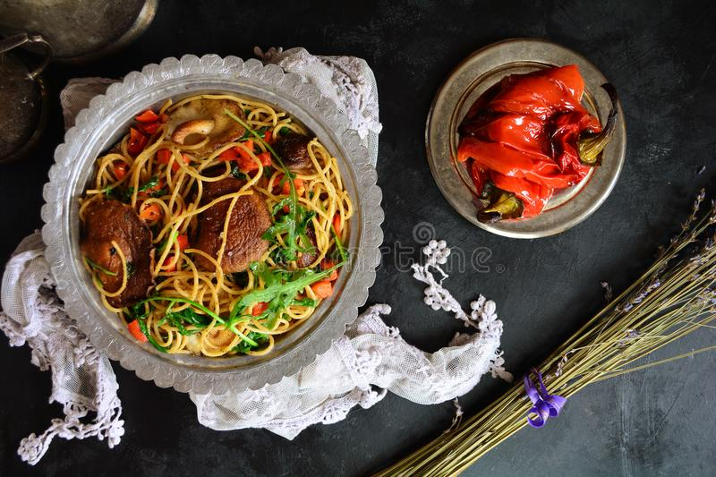 Whole Grain Spaghetti with Shiitake Mushrooms, Arugula, and Red Peppers royalty free stock images