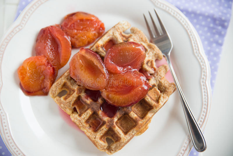 Whole Grain Waffles with plums stock images