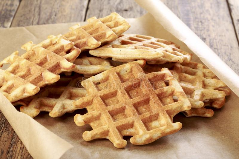 Whole grain waffles. On on a baking sheet royalty free stock images