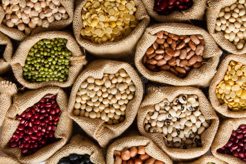 Whole grains of Legumes in sack. At grocery stock photos