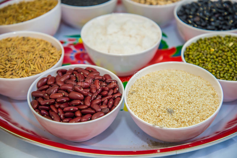 Whole grains. Many types of whole grains in the cup for Buddhist rituals royalty free stock photography