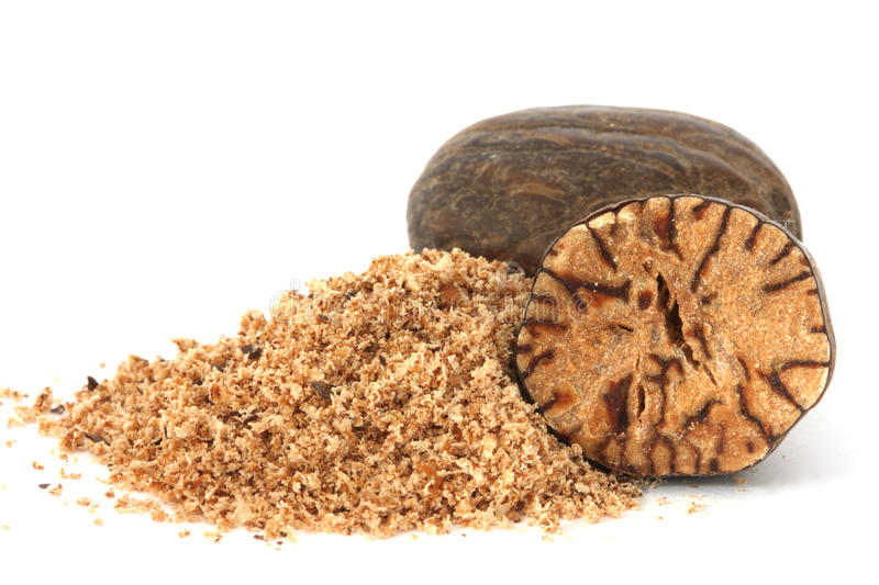 Whole and grated nutmeg closeup royalty free stock photos
