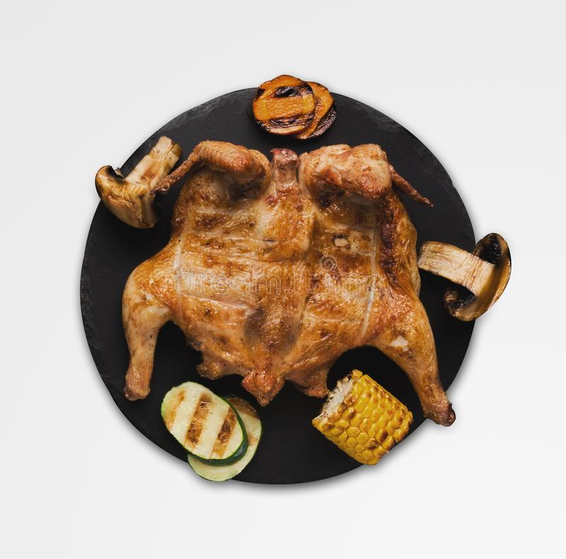 Whole grilled chicken with crispy golden skin, isolated on white royalty free stock photos