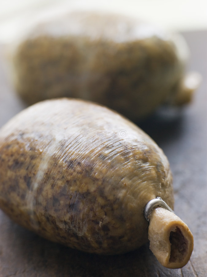 Whole Haggis on a Chopping Board royalty free stock images