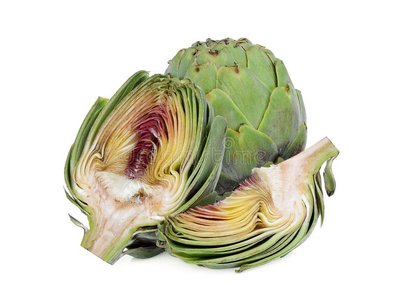 Whole and half artichoke with slice isolated on white royalty free stock image
