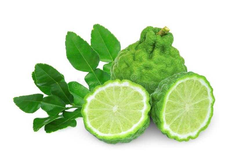 Whole and half bergamot with leaf isolated on white royalty free stock image