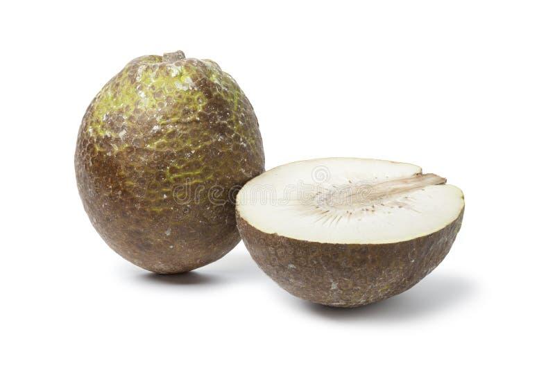 Whole and half breadfruit stock photo