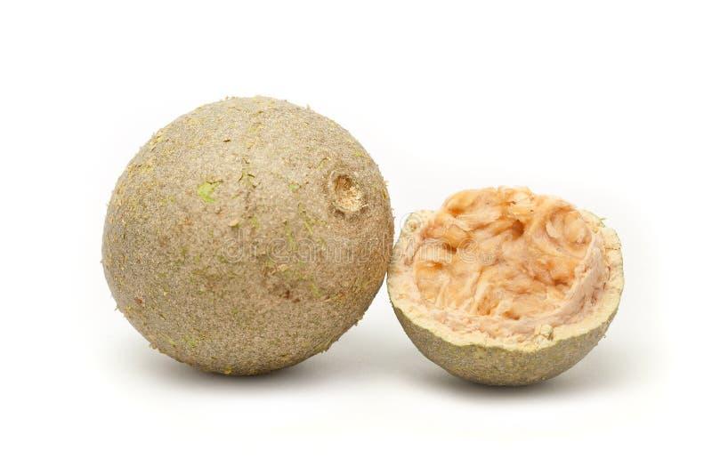A whole and A half cracked Organic Limonia (Limonia acidissima). stock image