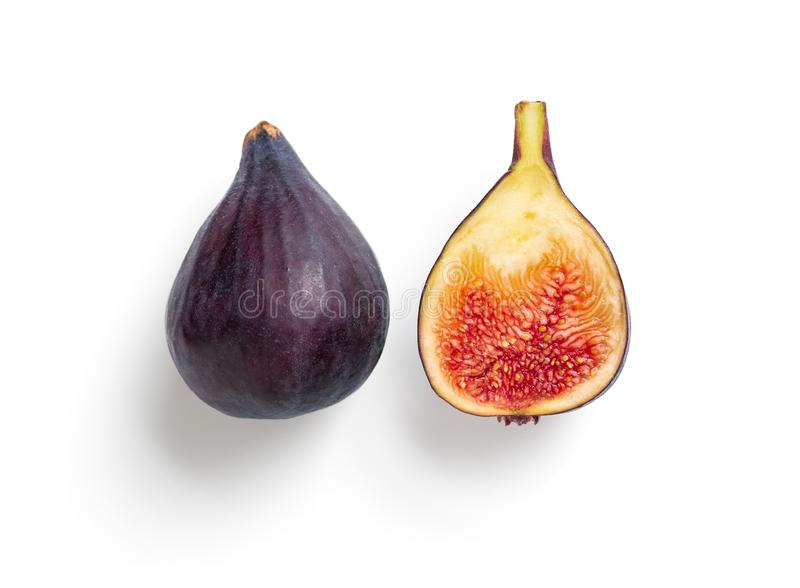 Whole and half figs isolated topview. Creative layout made of figs. Half and whole fig isolated on white with clipping path. Top view of ripe purple violet figs stock photos
