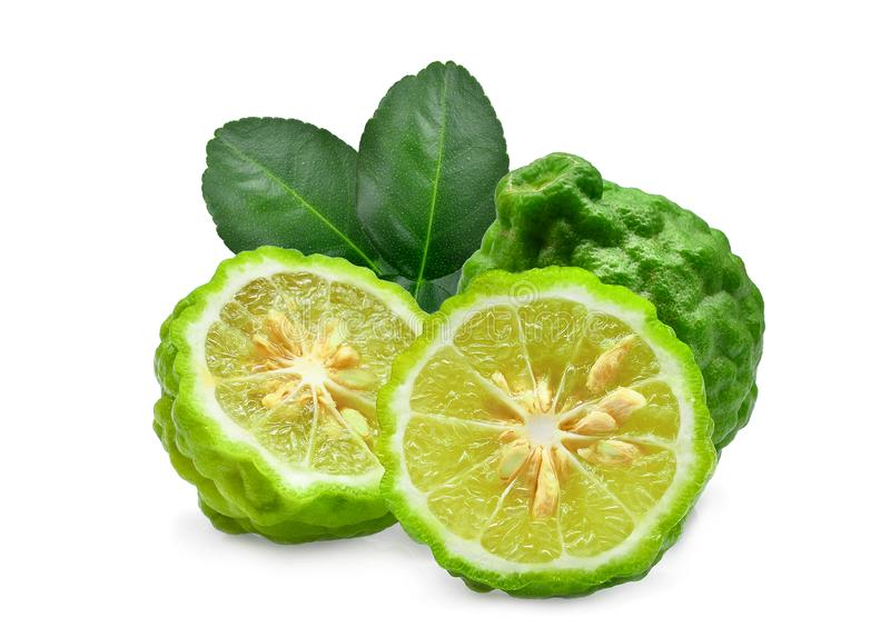 Whole and half fresh bergamot with green leaves isolated royalty free stock photography