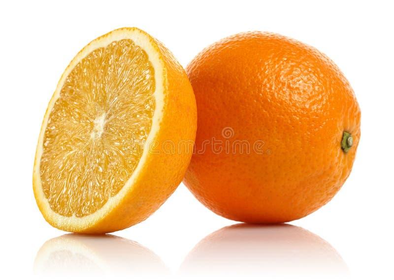 Whole and half fresh orange fruit isolated stock photography