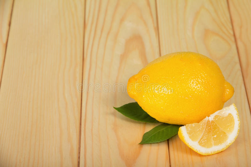 Download Whole And Half Lemon On Wooden Table Stock Image - Image: 35834229