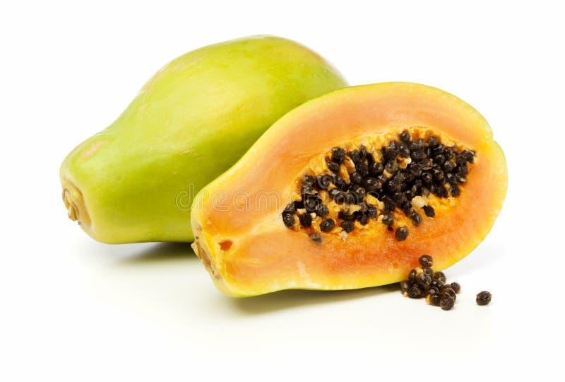 Whole and half Papaya fruit