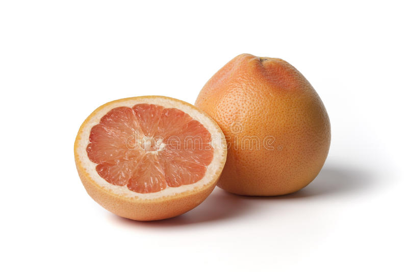Whole and half pink grapefruit royalty free stock photography