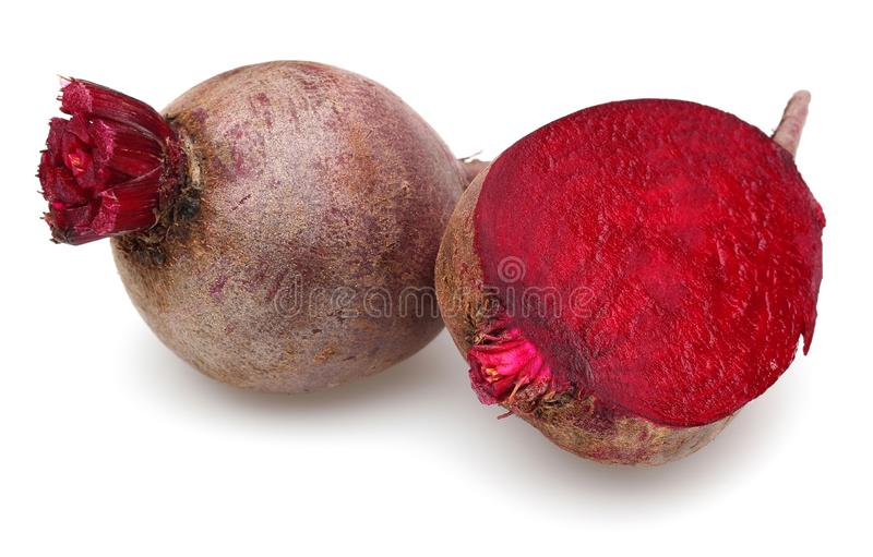 Whole and half red beet roots. Isolated on white background royalty free stock image