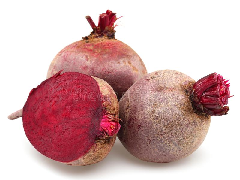 Whole and half red beet roots. Isolated on white background royalty free stock images