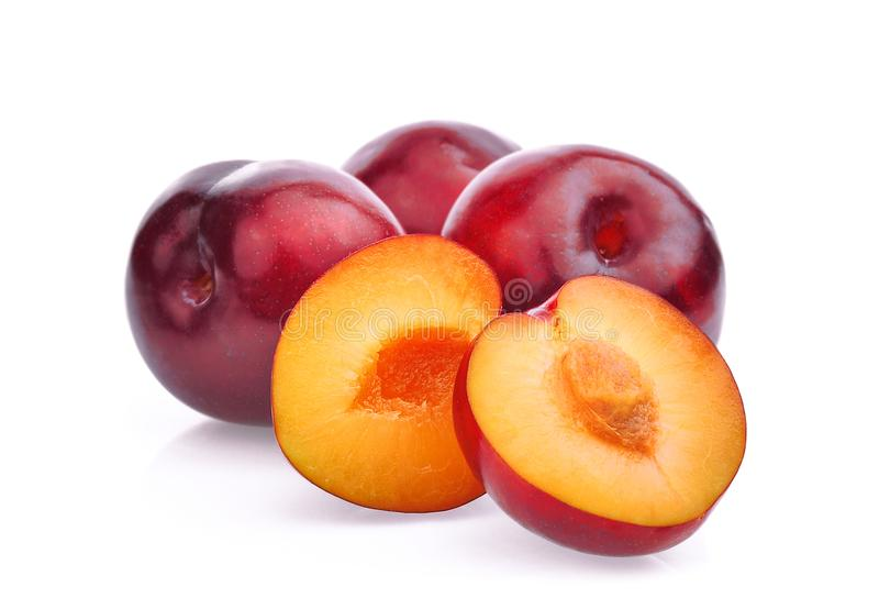 Whole and half with slice of red cherry plums isolated on white royalty free stock image