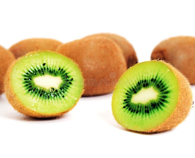 Whole and halved kiwifruit. Whole and halved ripe kiwifruit isolated on white background royalty free stock photo